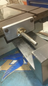 This is how the lead screw is mounted to the X-axis. I had to create the aluminium piece to fit the existing screw holes. I bought the lead screw and nut, and had to make some adjustments to them.